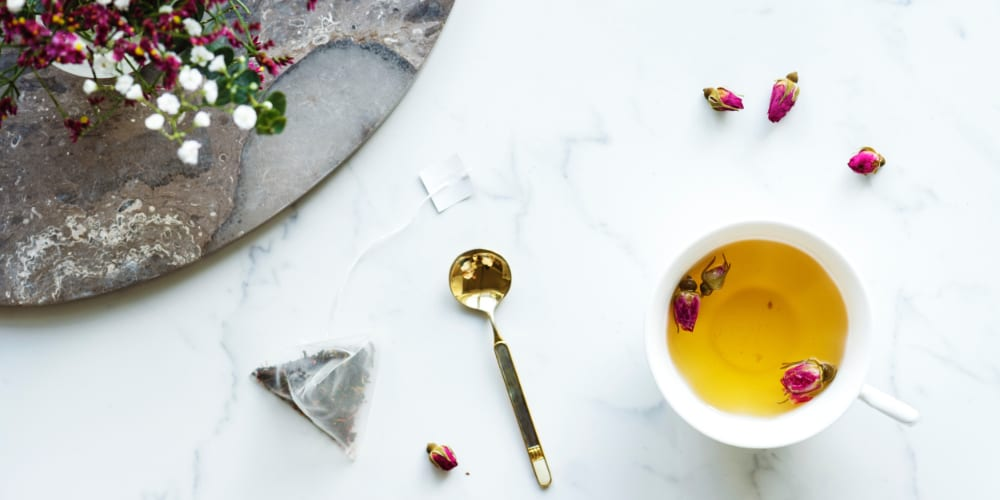 Ayurvedic massage rituals include herbal teas