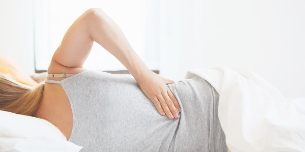Massage to alleviate sciatic nerve compression and lower back pain.