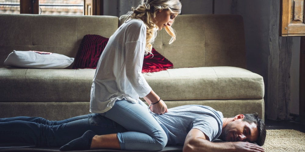 Lady massaging man, Valentine's Day, at home