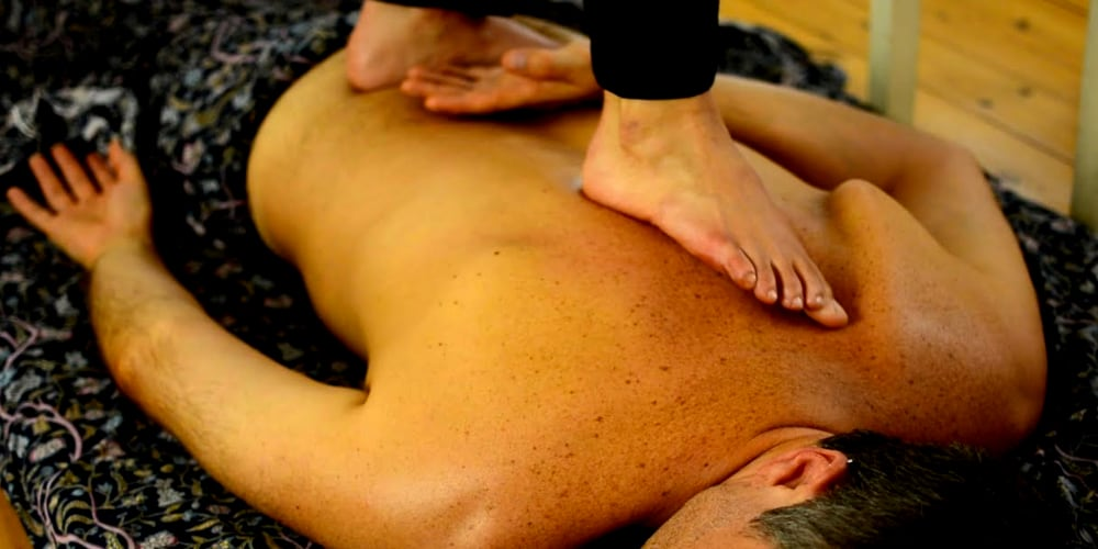 Ashiatsu massage, barefoot therapist, walking on back