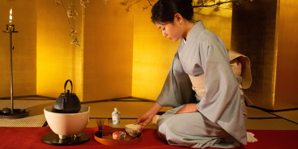 Japanese woman acting in a traditional manner, tea ceremony