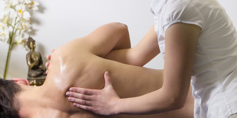 Masseuse giving a therapeutic massage in London