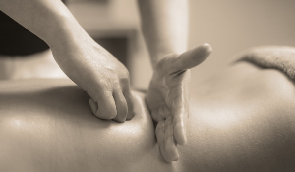 Strong Deep Tissue Massage being applied by a masseuse