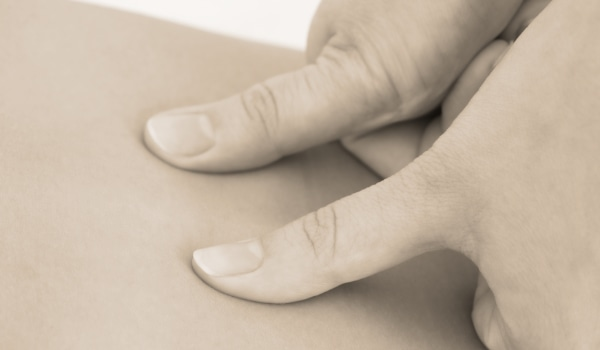 finger pressure point massage through shiatsu